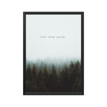 black framed motivational poster with text - 'just keep going' in natural background
