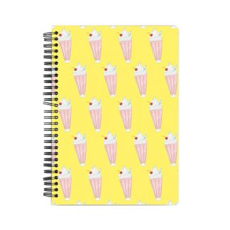 notebook with pink milkshakes on a yellow background