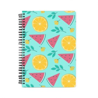 notebook with oranges and watermelons and leaves on a blue background