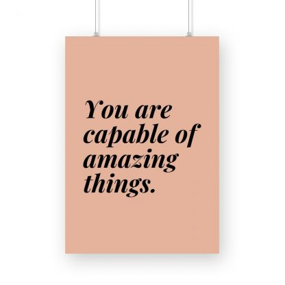 "poster with blck text ""you are capable of great things"" with pinkish-brown background."