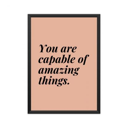 "framed poster with blck text ""you are capable of great things"" with pinkish-brown background."